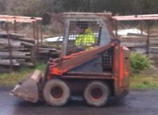 Belle 250 skid steer with Grab and Bucket. Only 1214 hours