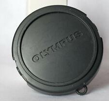Soft plastic Olympus 52mm edge pinch front lens cap.