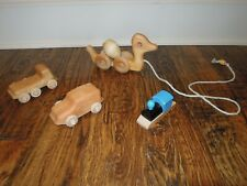 Rolling wooden vehicle & animal toys - lot of 4