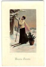 CPA fantaisie Bonne Année Jeune femme sur des skis fantasy postcard