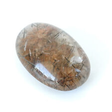 weight 69.50 ct Lot 714 Oval shape rutilated quartz cabochon,