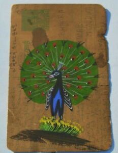 A NICE RAJASTHAN MINIATURE PAINTING ON A OLD  INDIAN POSTCARD OF A PEACOCK