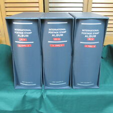 Box of three blue Jumbo Scott International Postage Stamp binders and slipcovers