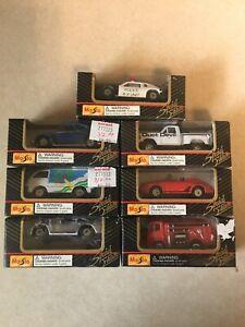 Maisto Lot of 7 Boxed Vehicles-VW, Van, Porche(2),Dust Devil Truck, Fire,Police