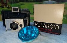 Vintage Polaroid Super Colorpack Land Camera and light filter