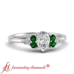 3/4 Carat Pear Shaped Diamond And Emerald Gemstone Engagement Ring In Platinum