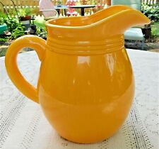VINTAGE MID-20th CENTURY ART POTTERY BRIGHT YELLOW PITCHER W/ GLAZE FINISH