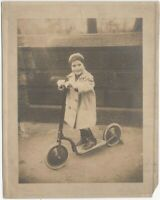 1920s Happy Young Boy on Toy Scooter in Winter Coat Children Photo