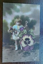 CUTE GIRL CHILD WITH FLOWERS 1918 POSTCARD