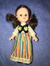 "Vintage 8""  plastic doll, posable arms & legs. blue, yellow, orange long dress"
