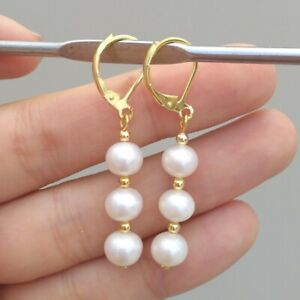 Refined AAA natural 8-7 MM round south sea white pearl earrings 14K Yellow Gold