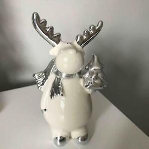 Lovely Christmas Ceramic Reindeer holding Silver Colour Tree Standing Decoration