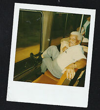 Old Vintage Polaroid Photograph African American Man Sitting on the Bus