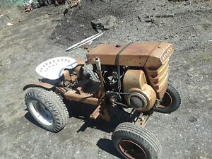 Vintage bolens garden tractor With a mower deck and snow blower. Runs and driv
