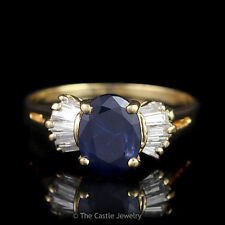 Oval Sapphire Ring with Baguette Diamond Accents Split Shank Design in 14K YG