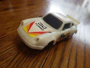 Porsche 930 (Turbo/Dunlop) Plastic Slot Car 1:43 (China) White