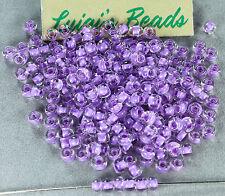6/0 Round  TOHO Japanese E Seed Glass Beads #943- Crystal/Lilac Lined  20 grams