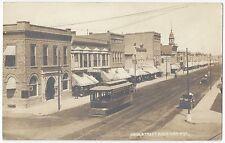 1912 Sheridan, Wyoming - REAL PHOTO Main Street, Railroad, Street Car, Bank