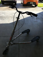 Trikke T67S 3 Wheel Scooter Fold In Half carving fitness gray