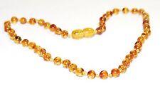 Baltic amber baby necklace, honey - bright cognac round shape beads 33 cm
