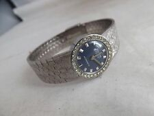 "a vintage ladies blue dialled stone set ""mortima "" dress watch"