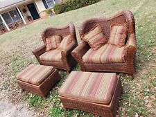 Rattan/Wicker Ottoman with cushions and foot rests. Good condition. 2 available.