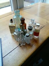 Selection Of 12 Old Glass Medicine Bottles.