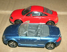 Two 1/64 Scale Audi TT Diecast Cars - Coupe and Roadster - Matchbox and RealToy