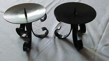 A PAIR OF BLACK METAL CANDLE HOLDERS WITH SCROLLED BASES 11cm  UNUSED