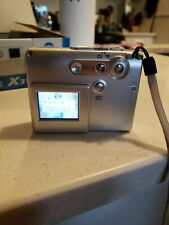 Konica Minolta Dimage X31 Digital Camera 3.2-Megapixel camera and cable only