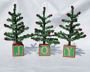 "NIB ROMAN SET OF 3 DECORATIVE LIGHTLY FLOCKED ""JOY"" CHRISTMAS TREES - 8.5"" HIGH"