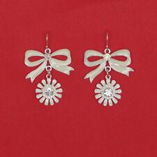 Silver tone white enamel bow and daisy dangle earrings
