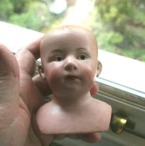 An Antique Gebruder Heubach Closed Mouth, Intaglio Eyes Bisque Shoulder Head
