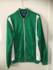 Adidas women's collectible  jacket green with trefoil logo.