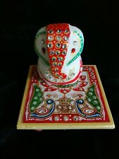 Chowki Ganesha in marble with handpainted and crystal work.