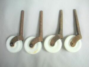 "4 Vintage White Porcelain & Iron Furniture Castor Trolley Wheel 1 7/8"" Diameter"