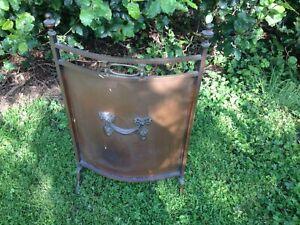 Antique copper fire screen.