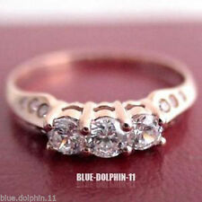 Cubic Zirconia Three-Stone Rose Gold Engagement Rings