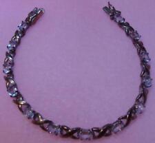 Vintage Sterling Silver Blue Topaz Tennis Bracelet X Link Design HUGS? Gemstones
