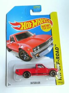 A12 1/64 Hot Wheels Datsun 620 Red.... Long Card USA .... shipped in a protector