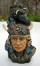 Sculpture of Native American in Headdress