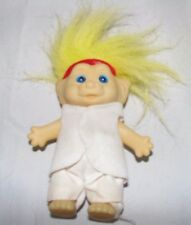 Vintage plastic troll made in Korea pale skin blue eyes yellow hair white outfit