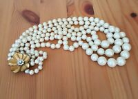 Vintage Carolee 3 Strand Simulated Pearl Necklace with Rhinestone Flower Clasp