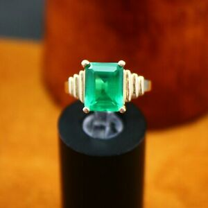 2 Ct Emerald Cut Emerald Solitaire 4-Prong Engagement Ring 14K Yellow Gold Over
