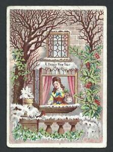 Y19 - LADY AT WINDOW LOOKING AT ROBIN - VICTORIAN NEW YEAR CARD