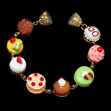 Gold Colored Statement Bracelet with Cake, Muffins and Cake Medallions