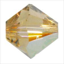 Lot de 40 perles Toupies SWAROVSKI 4mm Light Colorado Topaz AB