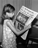 New 8x10 NASA Photo: Girl with Apollo 11 Lunar Moon Landing Newspaper, 1969