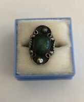 Mexican sterling silver ring with a green turquoise bezel set stone, 1950s