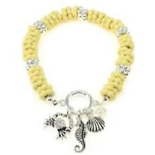 Beige Stretch Bracelet with Silver Toned Sea Life Themed Charms